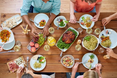 Photo pour group of people eating at table with food - image libre de droit