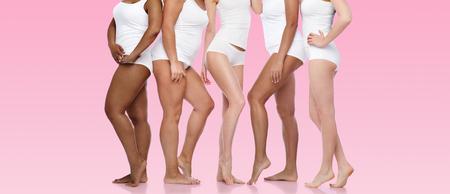 Photo pour group of happy diverse women in white underwear - image libre de droit