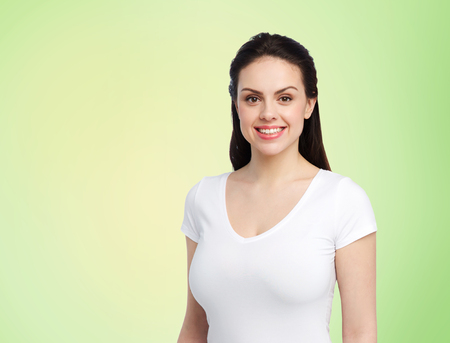 Photo for body positive and people concept - happy woman in white t-shirt over lime green background - Royalty Free Image