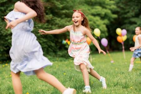 Photo for happy girls playing tag game at birthday party - Royalty Free Image