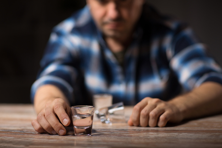 Photo pour man drinking alcohol at night - image libre de droit