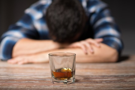 Photo pour drunk man with glass of alcohol on table at night - image libre de droit