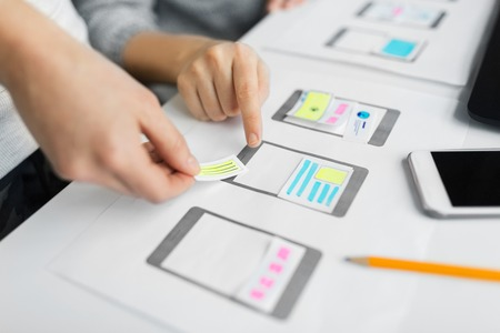 Foto de app design, technology and business concept - web designers or developers working on user interface wireframe layout at office - Imagen libre de derechos