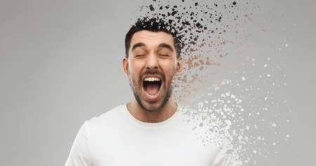 Photo pour crazy shouting man in t-shirt over gray background - image libre de droit