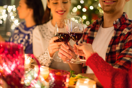 Photo for close up of friends with wine celebrate christmas - Royalty Free Image