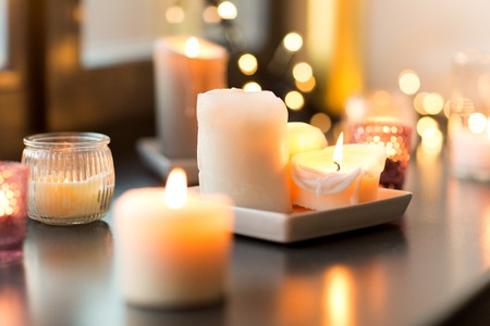 Photo for candles burning on window sill with garland lights - Royalty Free Image