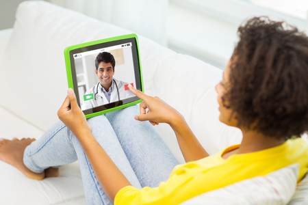 Foto de patient having video chat with doctor on tablet pc - Imagen libre de derechos