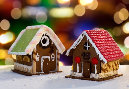 Photo for gingerbread houses over christmas lights - Royalty Free Image