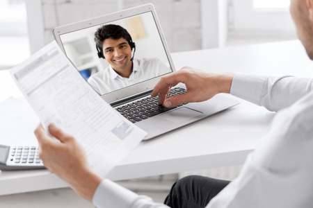 Photo pour businessman having video call on laptop at office - image libre de droit