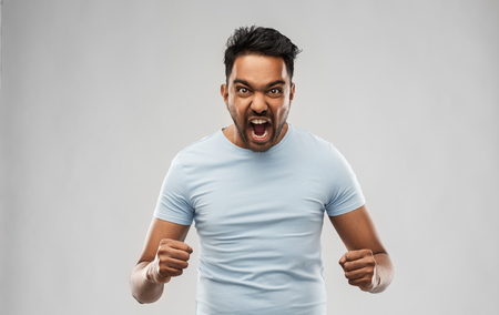 Photo pour angry indian man screaming over grey background - image libre de droit