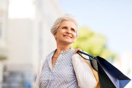 Foto de senior woman with shopping bags in city - Imagen libre de derechos
