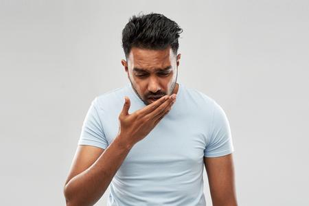 Foto de unhealthy indian man coughing - Imagen libre de derechos