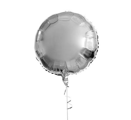 Photo pour one silver helium balloon over white background - image libre de droit