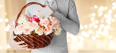 Photo for man holding basket of flowers with note - Royalty Free Image