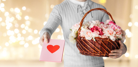 Photo for man holding basket of flowers with greeting card - Royalty Free Image