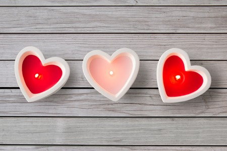 Photo for heart shaped candles burning on valentines day - Royalty Free Image