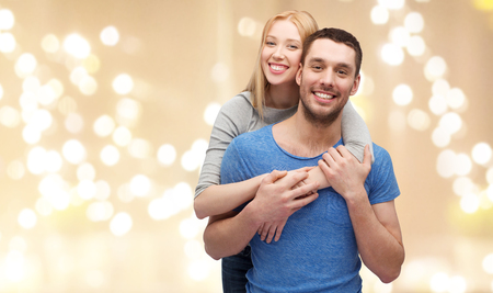 Photo for smiling couple hugging over festive lights - Royalty Free Image