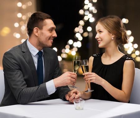 Photo pour couple with glasses of champagne at restaurant - image libre de droit