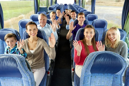 Foto per group of happy passengers travelling by bus - Immagine Royalty Free