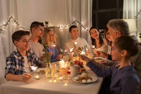Photo for family with sparklers having dinner party at home - Royalty Free Image