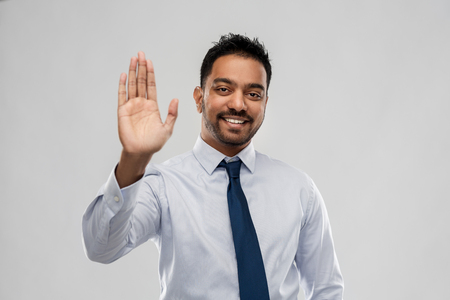 Foto de indian businessman making high five gesture - Imagen libre de derechos
