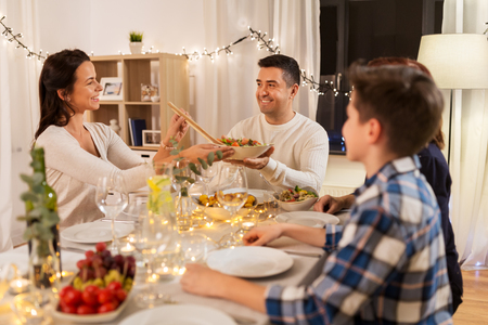 Foto de happy family having dinner party at home - Imagen libre de derechos