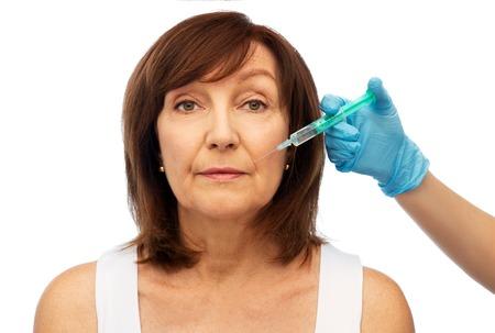 Photo pour senior woman and surgeon hand with syringe - image libre de droit