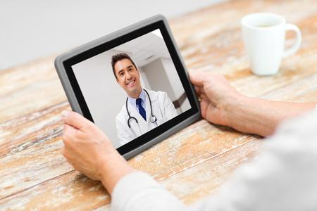 Photo pour senior woman patient having video call with doctor - image libre de droit
