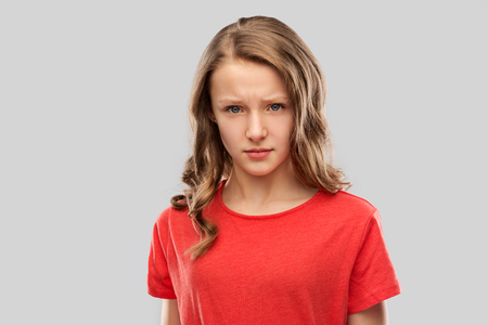 Photo pour sad or angry teenage girl in red t-shirt - image libre de droit