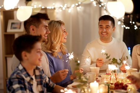 Foto de family with sparklers having tea party at home - Imagen libre de derechos