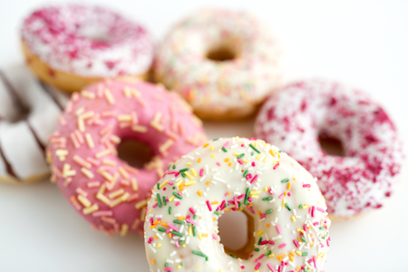 Photo for close up of glazed donuts on white table - Royalty Free Image