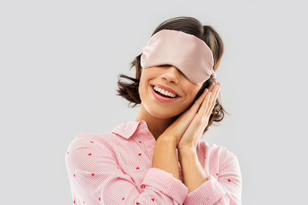 Photo pour happy young woman in pajama and eye sleeping mask - image libre de droit