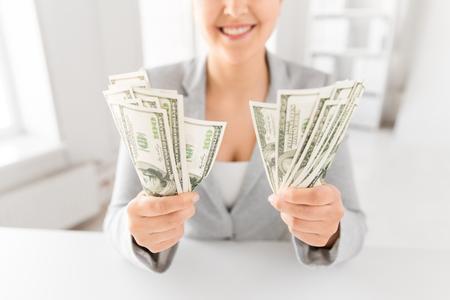 Foto de close up of woman hands holding us dollar money - Imagen libre de derechos