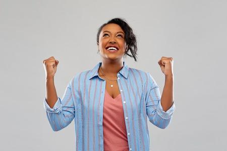 Foto de happy african american woman celebrating success - Imagen libre de derechos