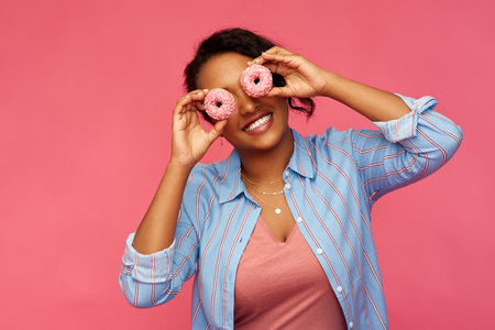 Photo for happy african american woman with eyes of donuts - Royalty Free Image