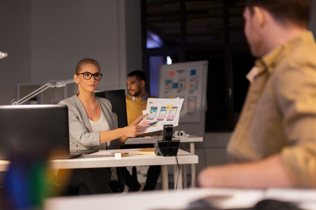 Foto de designers or software developers at night office - Imagen libre de derechos