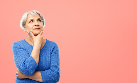 Photo pour portrait of senior woman in blue sweater thinking - image libre de droit