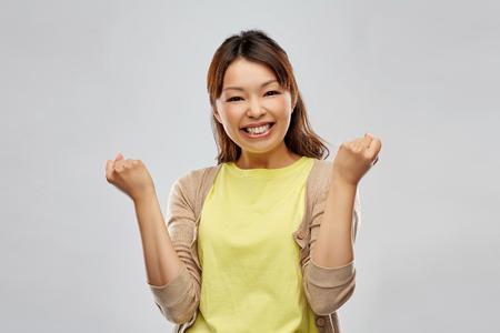 Foto de happy asian woman celebrating success - Imagen libre de derechos