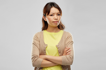 Photo pour displeased asian woman with crossed arms - image libre de droit