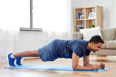 Photo for man doing plank exercise at home - Royalty Free Image
