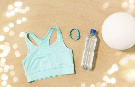 Foto de sports top, ball, fitness tracker and water bottle - Imagen libre de derechos
