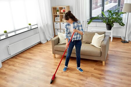Photo for asian woman with broom sweeping floor and cleaning - Royalty Free Image