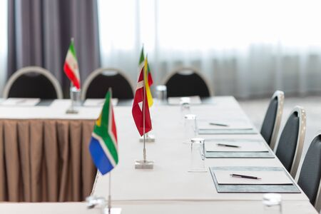 Photo for table in boardroom at international conference - Royalty Free Image