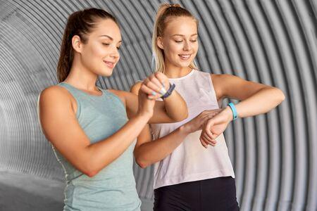 Foto de women or female friends with fitness trackers - Imagen libre de derechos