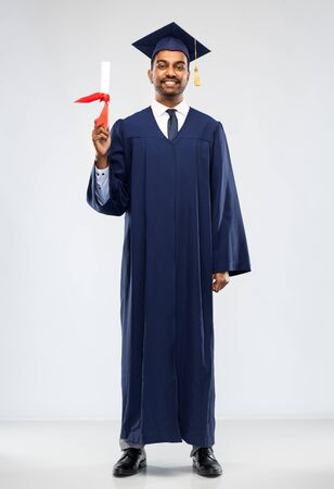 Photo for graduate student in mortar board with diploma - Royalty Free Image