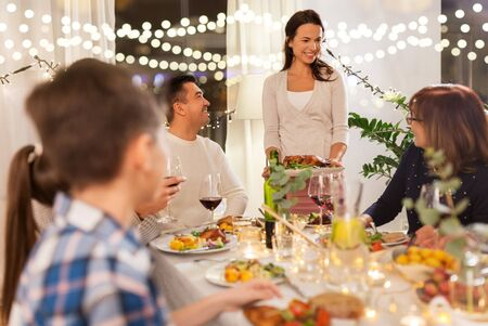 Photo pour happy family having dinner party at home - image libre de droit