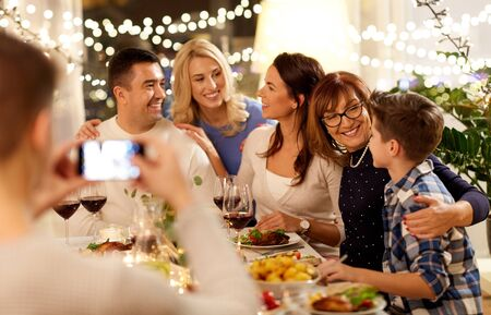 Photo pour family having dinner party and taking selfie - image libre de droit