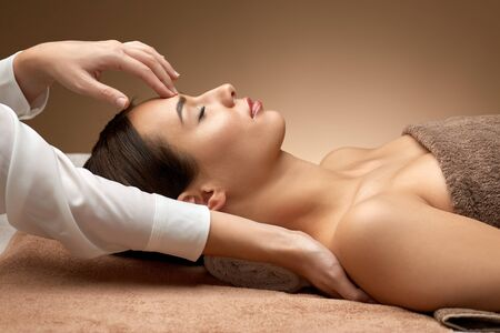 Photo for woman having face and head massage at spa - Royalty Free Image