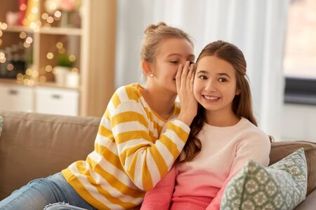Photo for happy teenage girls gossiping at home - Royalty Free Image