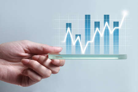 Foto de Hand showing blue business chart on smartphone, representing business growth. The background is white, chart colors are white and blue. - Imagen libre de derechos